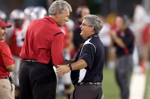 UNLV supporter Dean McQuillan, left, talks with UNLV interim athletic director Jerry Koloskie o ...