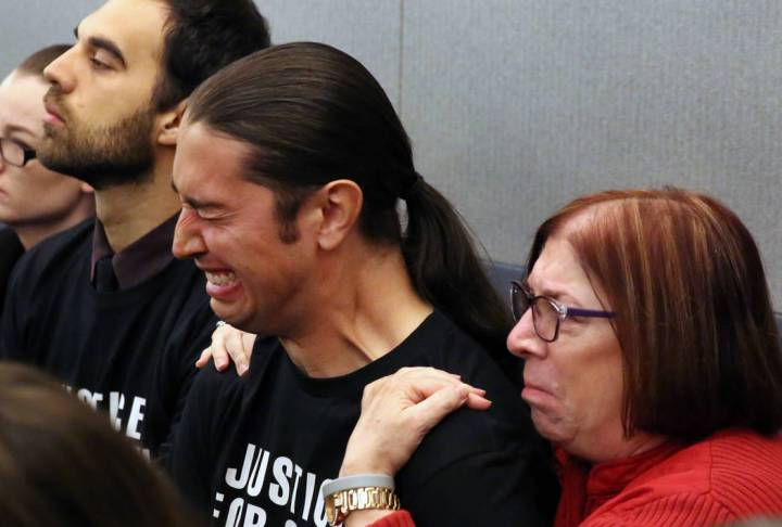 Jennifer Gee Mandarino, right, the mother of murder victim Sean Babbitt, comforts her son Chris ...