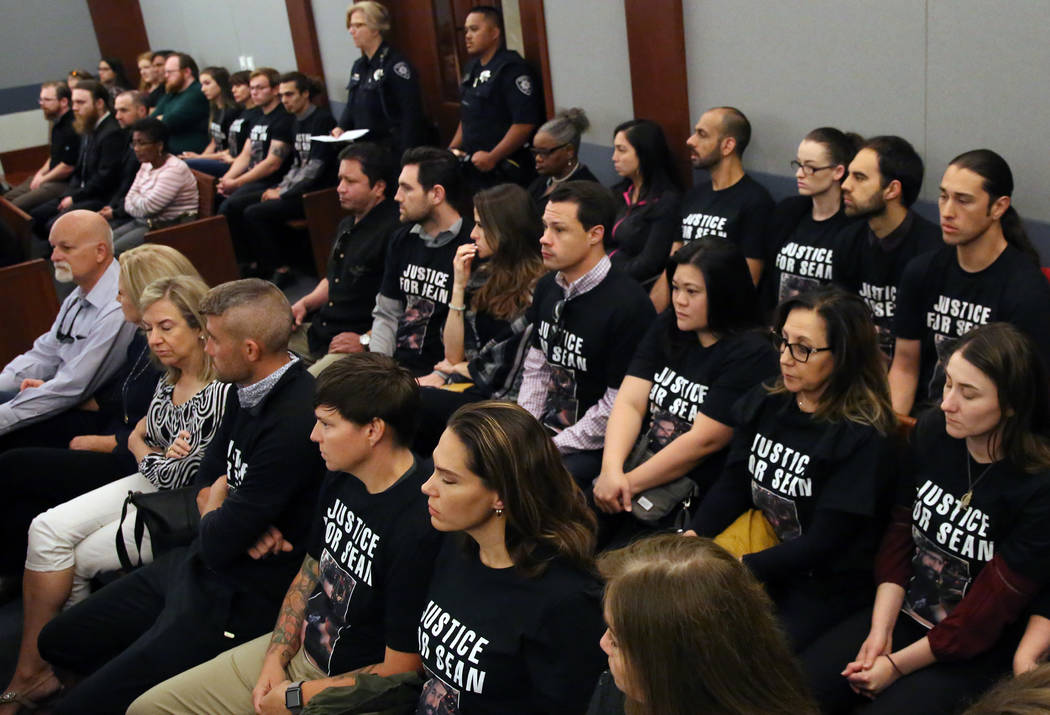"Family members and friends wearing ''Justice for Sean"" T-shirts attend former Metro office ..."