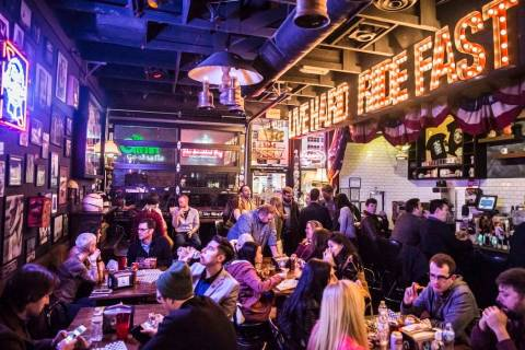Diners eat and drink at Evel Pie, an Evel Knievel-themed pizzeria, on Fremont Street in downtow ...