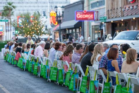 Guests sit family-style at a long table for Project Dinner Table at Downtown3rd in 2014. (Speci ...
