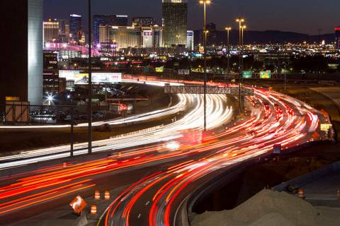 Traffic moves along Interstate 15 as seen from the Spaghetti Bowl in Las Vegas on Sunday, Janua ...