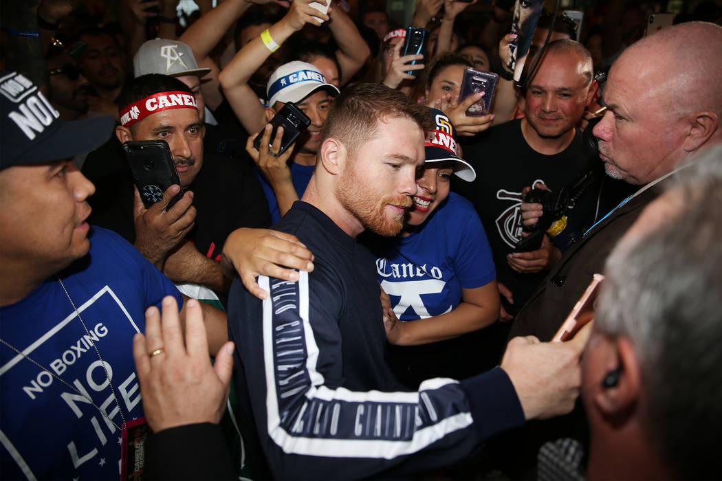 """Saul """"Canelo"""" Alvarez takes a photo with a fan during his grand arrival at MGM Grand ..."""