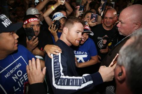 "Saul ""Canelo"" Alvarez takes a photo with a fan during his grand arrival at MGM Grand ..."