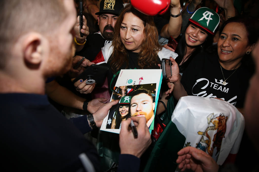 """Saul """"Canelo"""" Alvarez signs an autograph during his grand arrival at MGM Grand hotel- ..."""