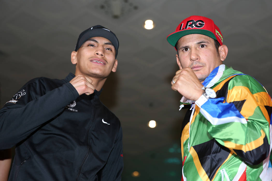 Vergil Ortiz Jr., left, and Mauricio Herrera pose during their grand arrival at MGM Grand hotel ...