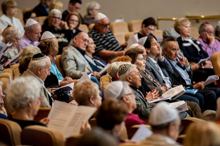 Jews come together to listen to readings, speakers and music during a Yom Hashoah service to re ...