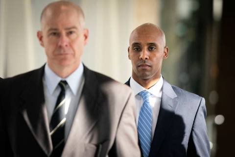 Former Minneapolis police officer Mohamed Noor walks through the skyway with his attorney Thoma ...