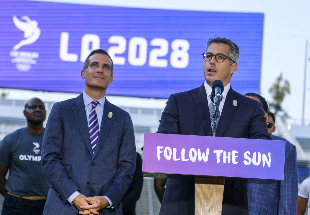 FILE - In this July 31, 2017, file photo, Los Angeles Mayor Eric Garcetti, left, listens as Los ...