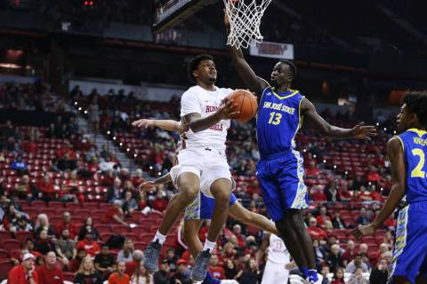 UNLV Rebels forward Tervell Beck (14) goes up for a shot under pressure from San Jose State Spa ...