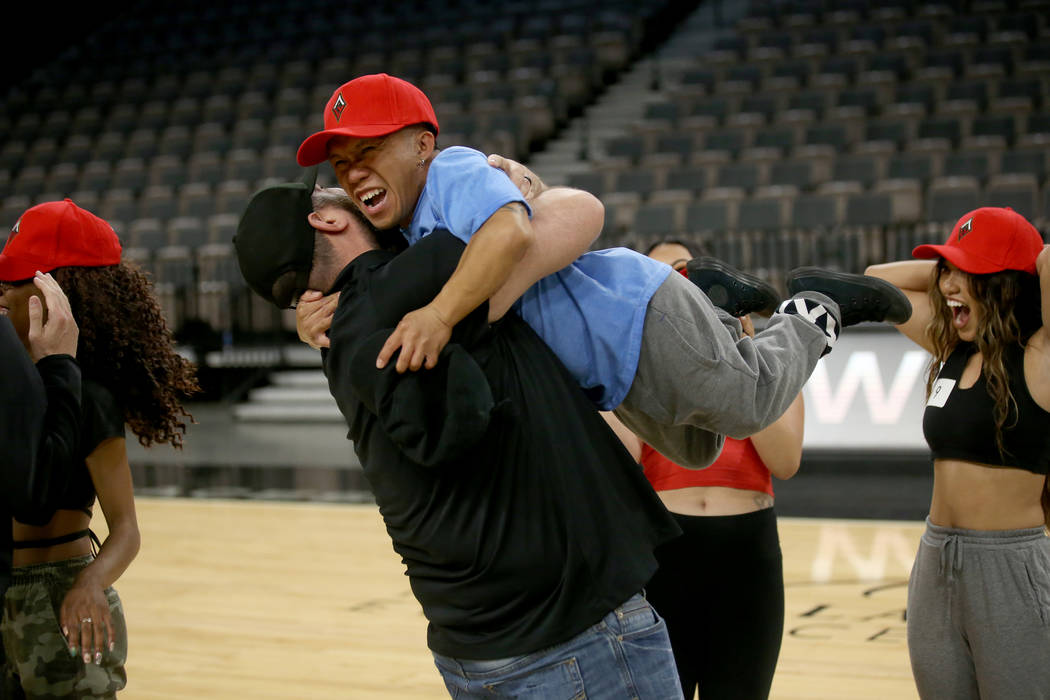 WNBA Las Vegas Aces Wild Card Crew member Jordan Cline, 34, of Las Vegas, facing, gets a hug fr ...