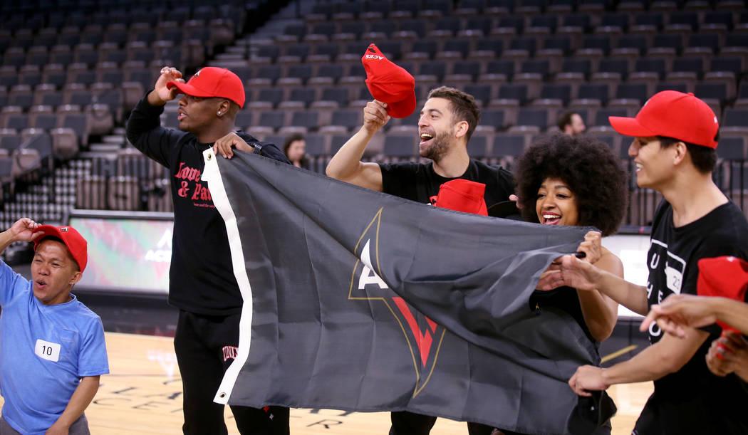 Members of the WNBA Las Vegas Aces Wild Card Crew, from left, Jordan Cline, 34, of Las Vegas, J ...