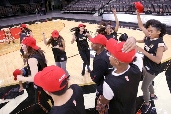 Members of the WNBA Las Vegas Aces Wild Card Crew, celebrate after finding out they made the te ...