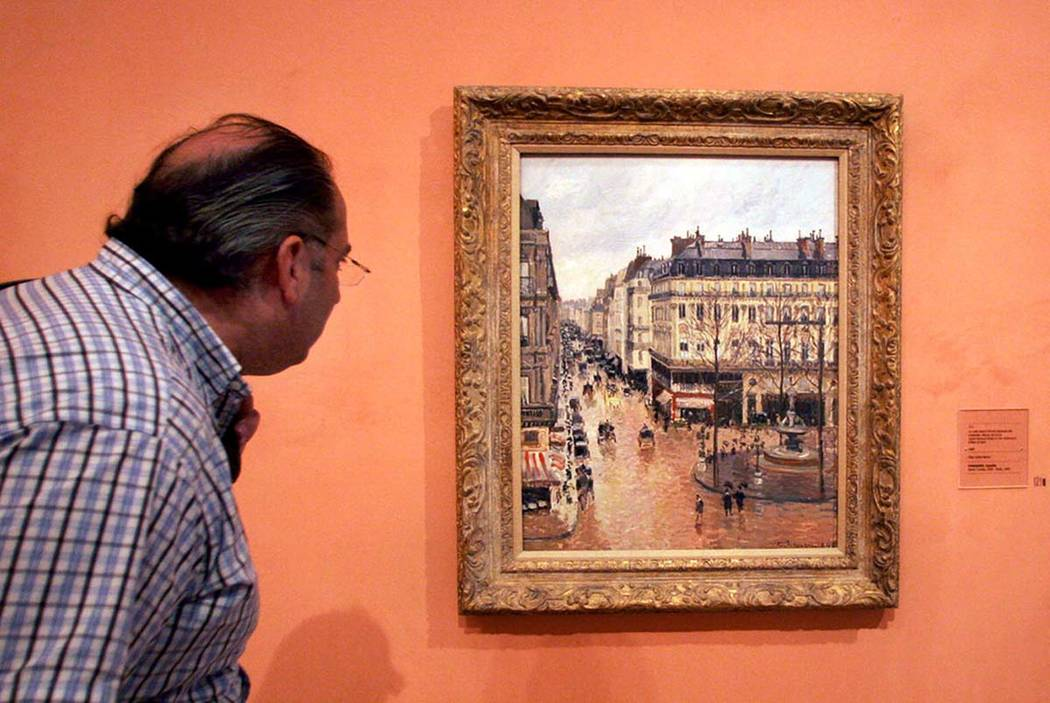 This May 12, 2005 file photo shows an unidentified visitor viewing the Impressionist painting c ...