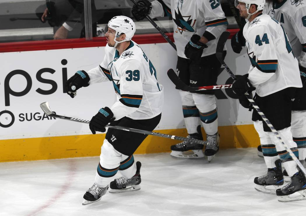 San Jose Sharks center Logan Couture celebrates after scoring an empty-net goal against the Col ...