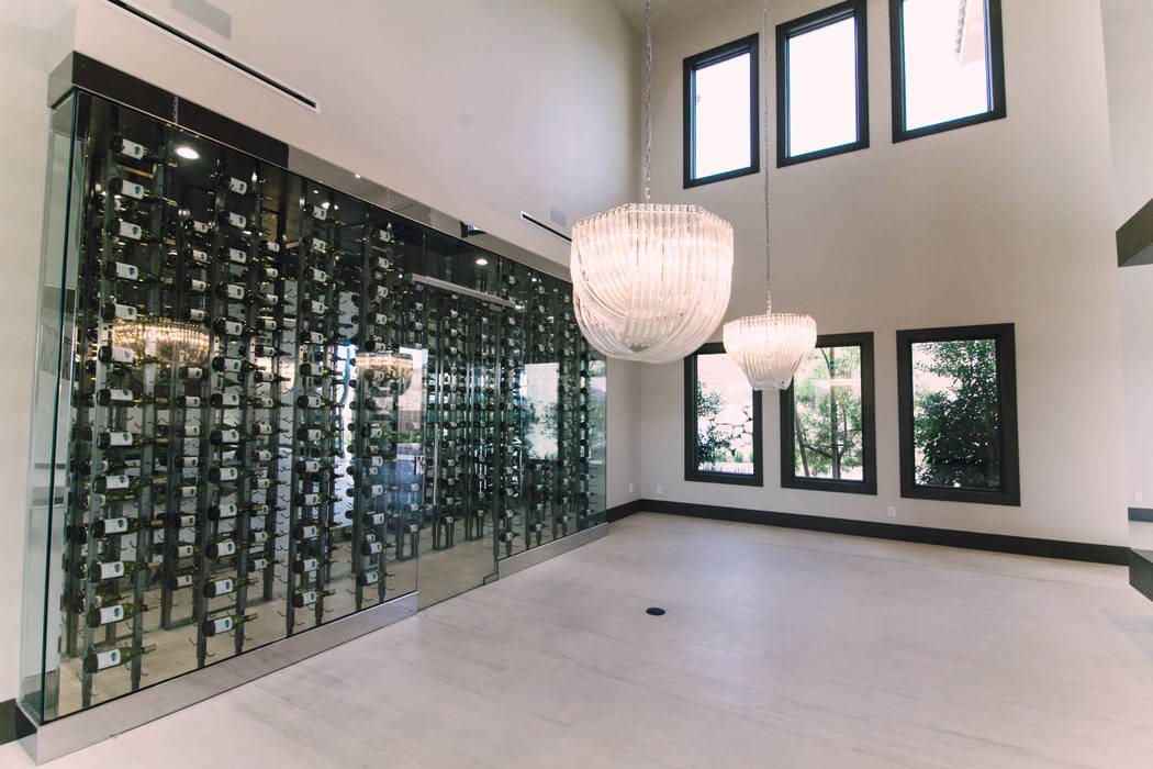 A wine wall is part of the dining area. (Growth Luxury Homes)