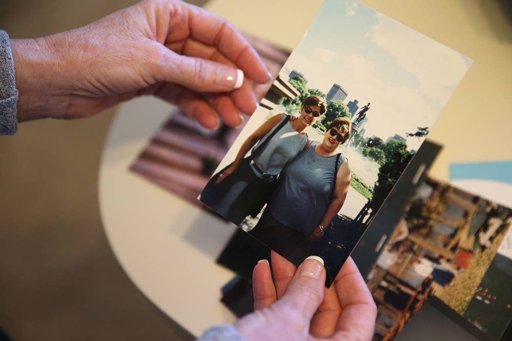 Bea Aikens shows a picture of herself with her sister Lanie, at her Boulder City home, Thursday ...