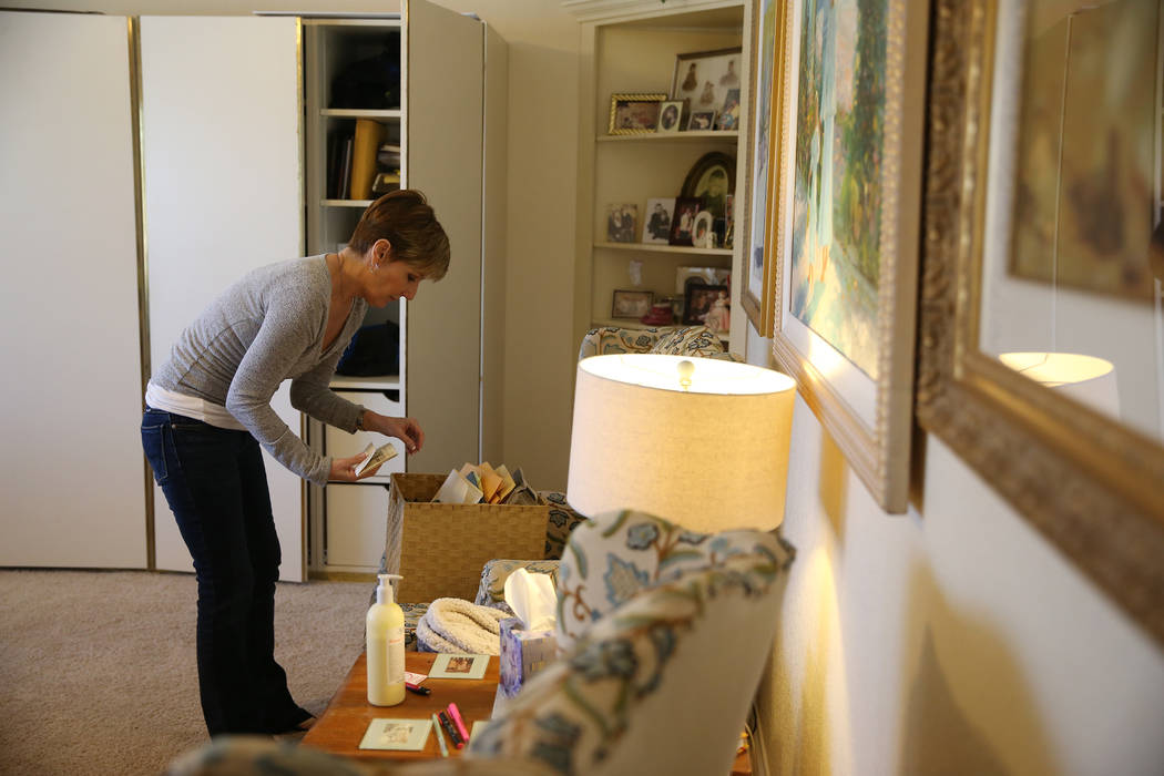 Bea Aikens looks through her sister's belonging at her Boulder City home, Thursday, Feb. 28, 20 ...
