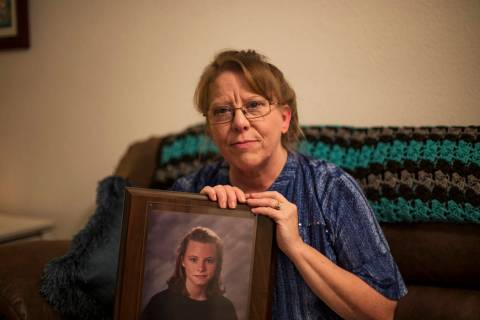 Rhonda Hunnel holds a portrait of her daughter Regina Krieger at her home in Henderson, Wednesd ...