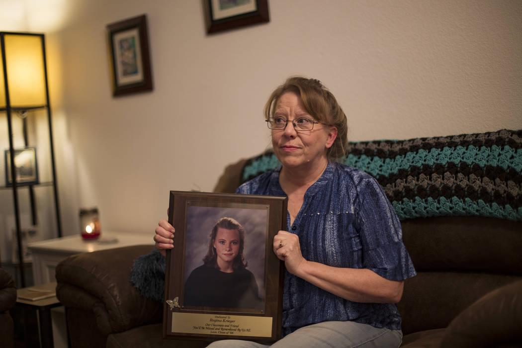 Rhonda Hunnel holds a portrait of her daughter Regina Kreiger at her home in Henderson, Wednesd ...