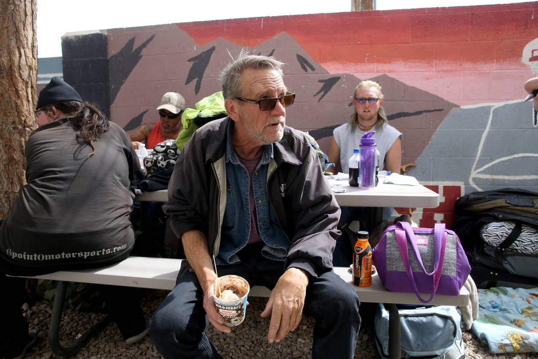 Mike Brennan, 66, talks to a reporter at the City of Las Vegas Courtyard Homeless Resource Cent ...
