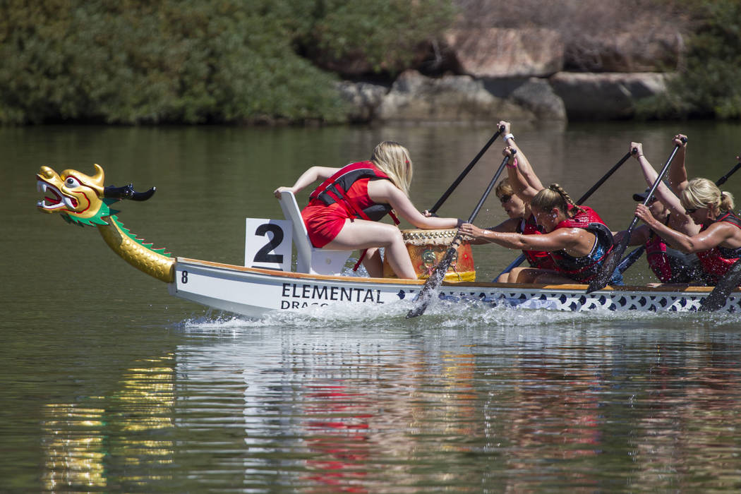 Members of the Skittles dragon boat race team participate in a race during the Nevada Internati ...