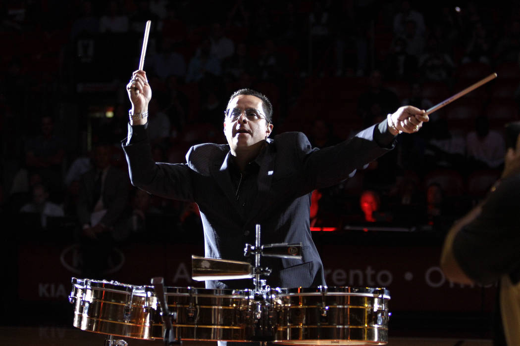 Tito Puente Jr. performs before an NBA basketball game between the Miami Heat and San Antonio S ...