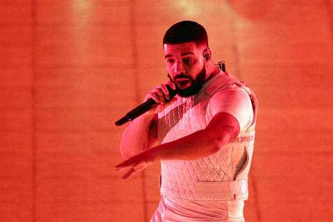 Drake performs during the Aubrey & the Three Migos Tour at State Farm Arena on Friday, Nove ...