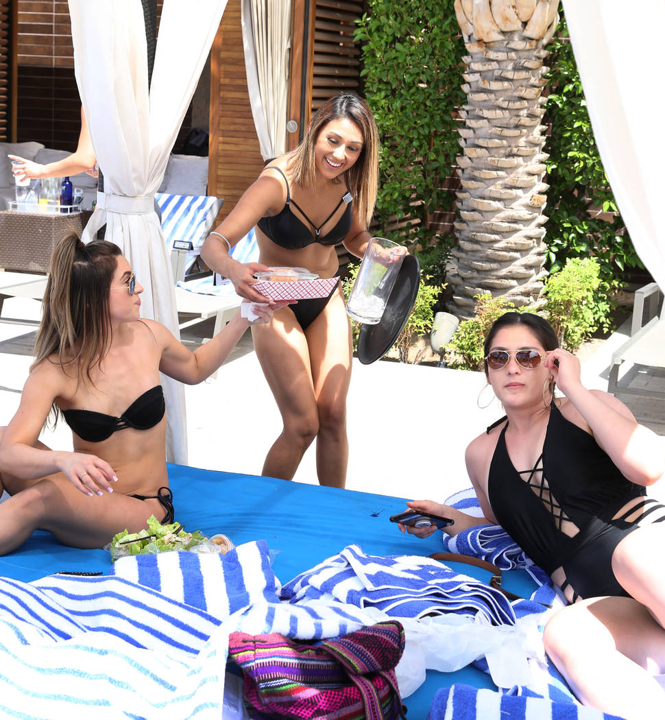 Lilia Chavez serves lunch at M Resort Spa Casino pool area on Saturday, April 27, 2019, in Hend ...