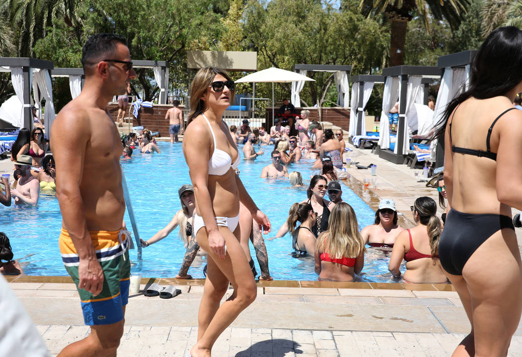 Hotel guests relax at M Resort Spa Casino pool on Saturday, April 27, 2019, in Henderson. (Bizu ...