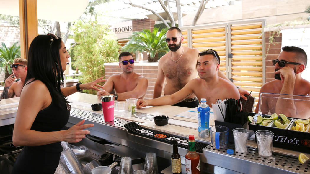 Lala Aghazarian serves drinks to gusts at M Resort Spa Casino pool area on Saturday, April 27, ...