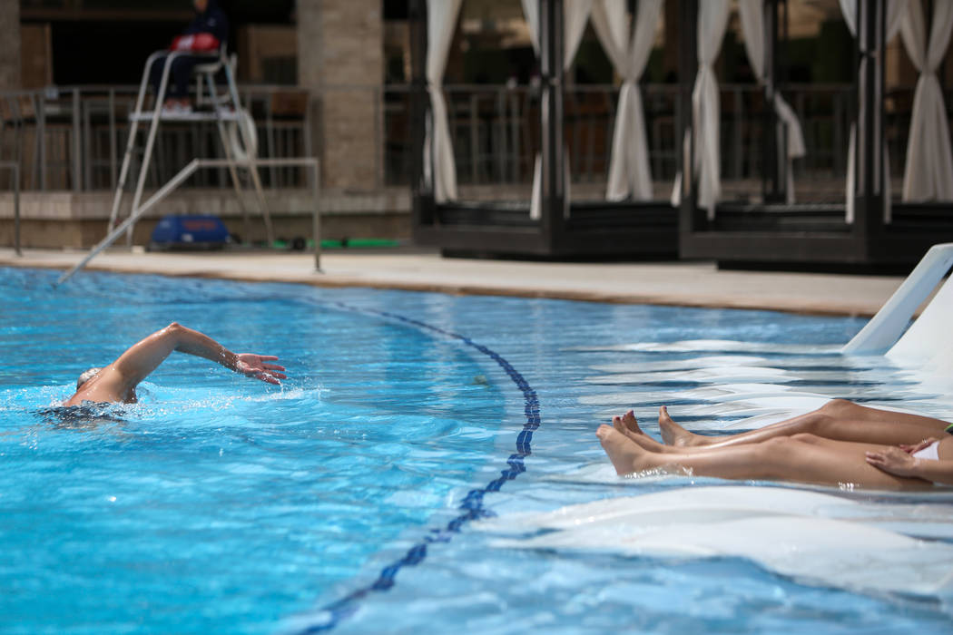 People relax out at the pool at the M Resort in Henderson, Thursday, April 4, 2019. (Caroline B ...