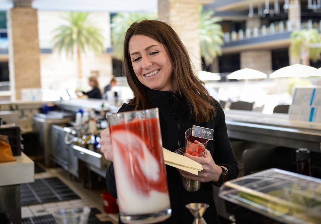 Bartender Cassie Leith makes a drink at the pool bar at the M Resort in Henderson, Thursday, Ap ...