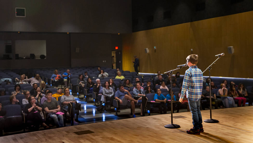 """Forbuss Elementary School student Reed Hambly performs """"Purple, Green and Yellow"""" dur ..."""