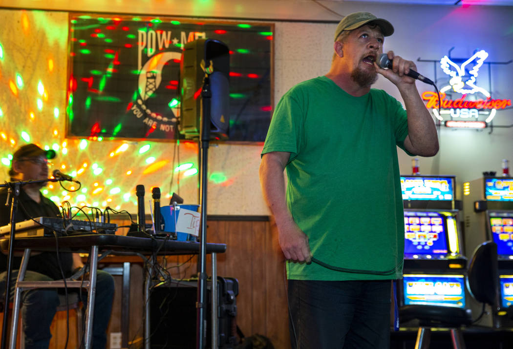 Ron Cochran sings some country music while joining a group of friends during their weekly karao ...