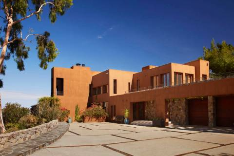 Bold and intense color choices can really enhance the drama and visual of a desert modern home. ...