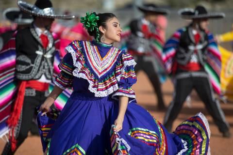 Mariajose Valdez, left, a dancer with Federación de Poblanos en Las Vegas performs during a C ...