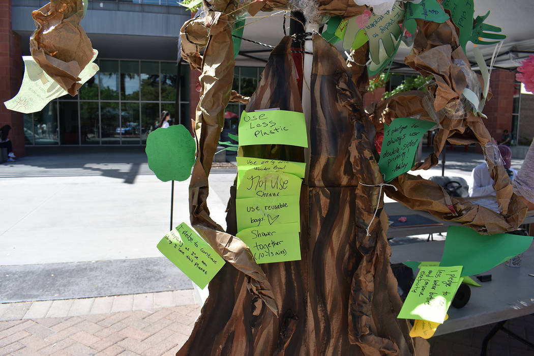 The Pledge Tree at the Earth Day event, where students posted ways they would try to protect th ...