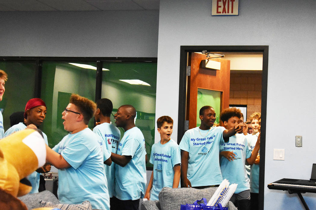 Teenagers of the Southern Highlands Boys and Girls club walk into their newly renovated Teen Ce ...