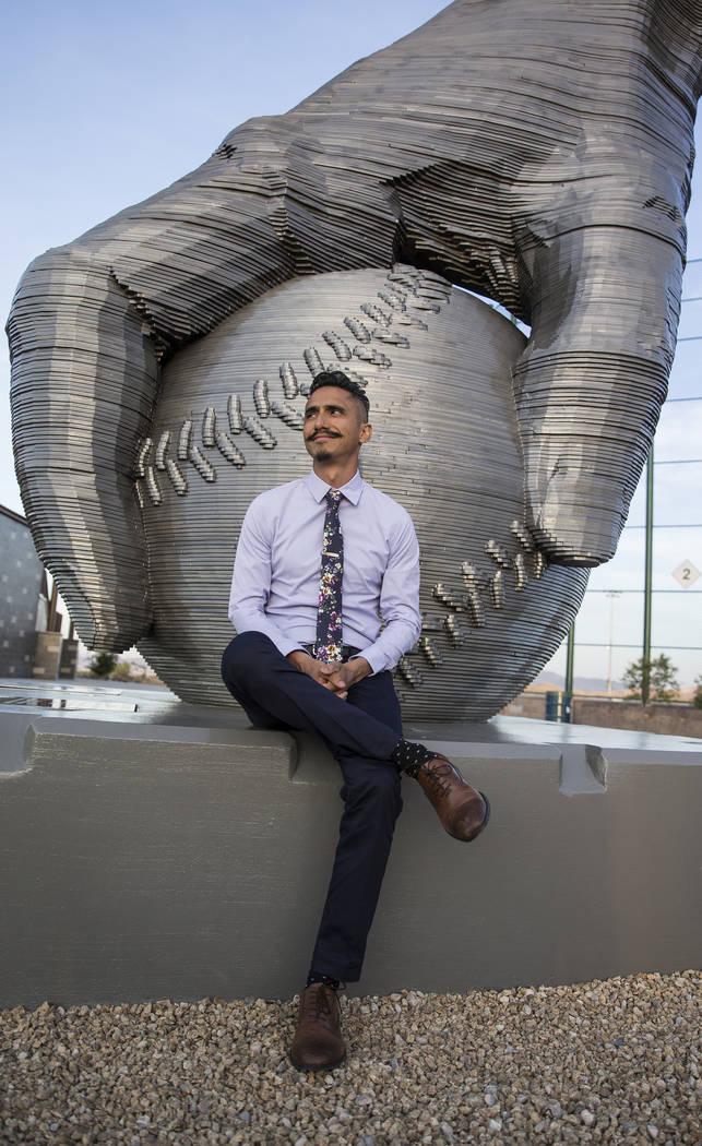 "Artist Luis Varela-Rico with his sculpture ""Organic Study No. 2"" during a dedication ..."