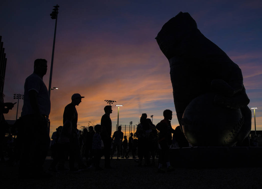 "People view artist Luis Varela-Rico's sculpture ""Organic Study No. 2"" at sunset durin ..."