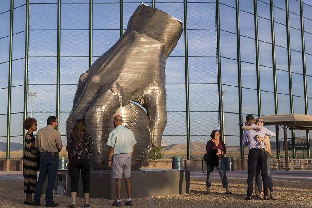 "People view artist Luis Varela-Rico's sculpture ""Organic Study No. 2"" during a dedica ..."