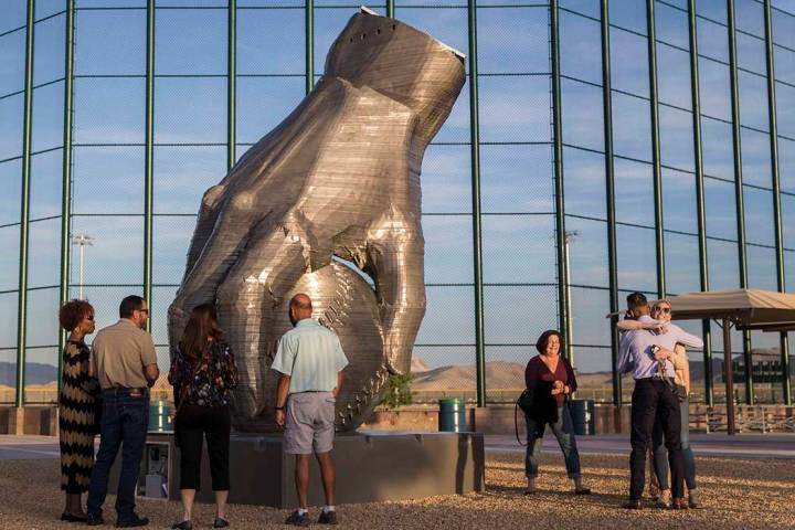 "People view artist Luis Varela-Rico's sculpture ""Organic Study No. 2"" during a dedica ..."