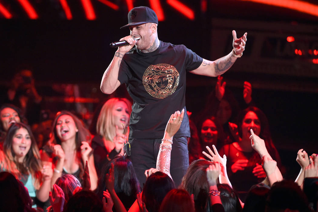 Nicky Jam performs a medley at the 16th annual Latin Grammy Awards at the MGM Grand Garden Aren ...