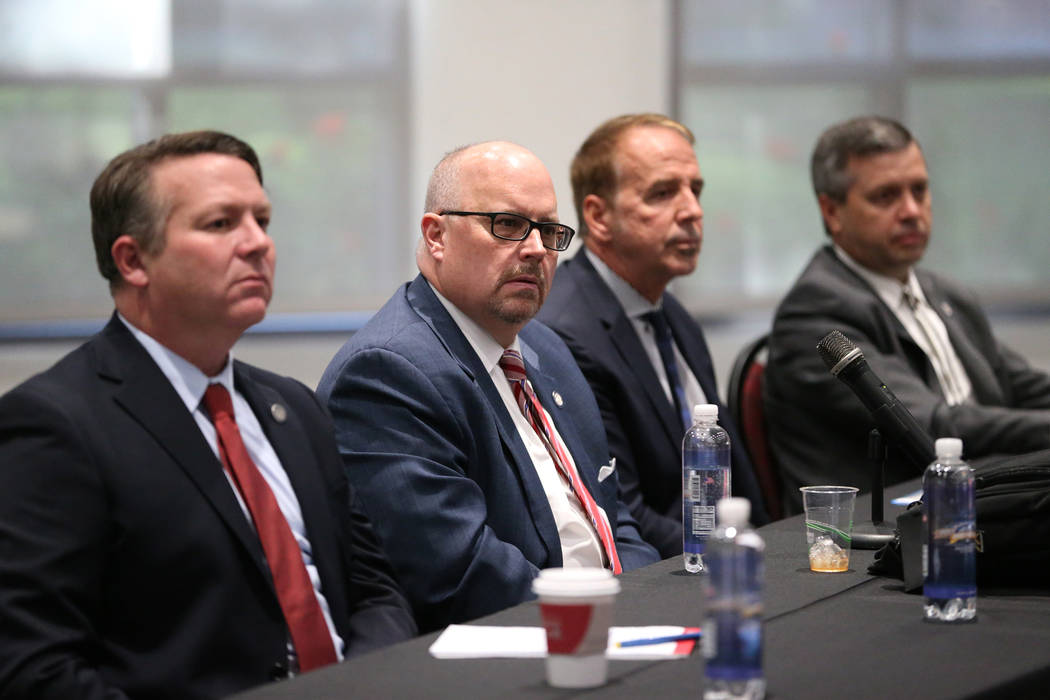 Nevada System of Higher Education's Chief General Counsel Joe Reynolds, from left, Regent Kevin ...