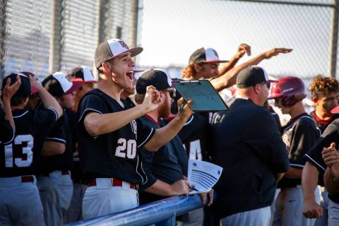 Desert Oasis pitcher Jacob Baca (20) cheers along with his teammates after three runs are score ...