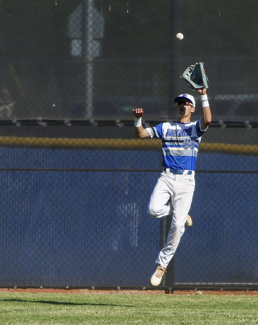 Basic first baseman John Howard Bobo (99) jumps up to catch a ball in the fourth inning of a ba ...