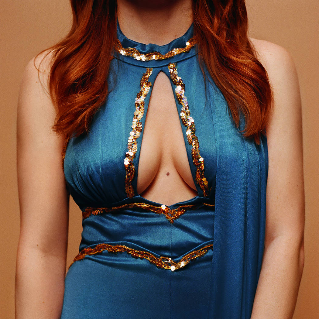 "The cover of Jenny Lewis' latest album, ""On the Line,"" features her wearing an outfit similar t ..."