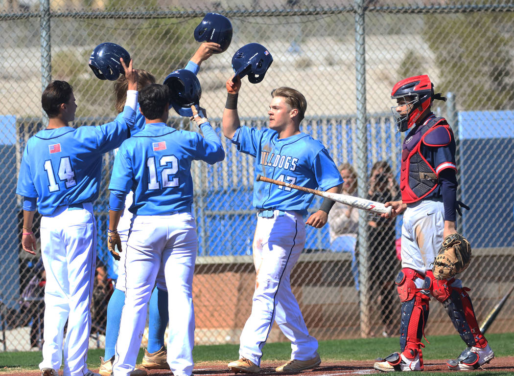 Centennial's Austin Kryszczuk (47) celebrates with his teammates after hitting a 3-run homer as ...