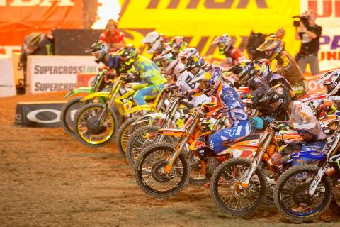 450SX Supercross riders take off at the start of the Monster Energy AMA Supercross 450SX champi ...